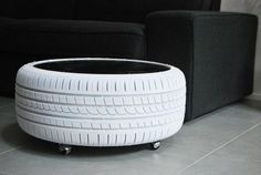 white tire table and black plexiglass top
