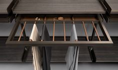 Trousers rack with belts tray in regenerated beaver leather finishing