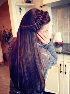 woah her hair is amazing!!! love how it's long and brown and then the braid is just soo awesome!! :D