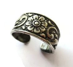 SOLD. Vintage 830 silver floral adjustable ring, Eric Christophersen of Sandnes Norway, Norwegian wide flowery open band, Scandinavian silver. https://www.etsy.com/listing/274057416/vintage-830-silver-floral-adjustable