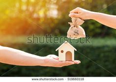 Loans for real estate concept, a man and a women hand holding a money bag and a model home put together in the public park. Mortgage Rates, New Homeowner, Model Homes, Home Buying, Need To Know, Pay Taxes, Photo Editing, Real Estate, Concept
