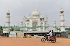 A motorist rides past a model of the Taj Mahal in Bangalore on January 3, 2018. (MANJUNATH KIRAN/AFP/Getty Images)