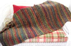 """sale! lots of pretty colors! :)     ITEM #2344 / 'FIESTA' LION BRAND HOMESPUN YARN / painterly color purple, green, red, and gold / 24-26"""" x 60-62"""" / $75.00"""