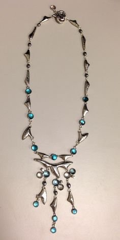White & blue topaz, diamonds, set in silver plated in rhodium necklace