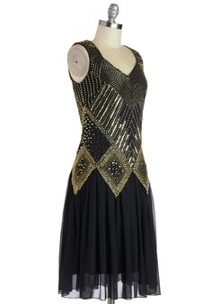 Sleeveless lined black chiffon flapper dress with wide straps & diamond neckline, rear kite-shaped cutout with triple covered-button closure, geometric gold heavily beaded overlay to dropped waist, knee-length skirt, and back invisible zipper. 100% polyester, from ModCloth, $189.99