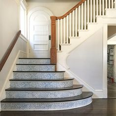 Removable Raindrops wallpaper tiles on stair risers. Easy project, big impact!