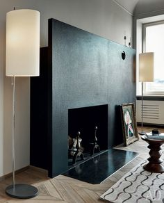 Wow. Ultra minimal fireplace. An expanse of black to frame the flames. Daring and simple and so sophisticated.