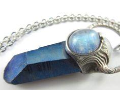 the blue star  blue titanium aura crystal by callistojewelry
