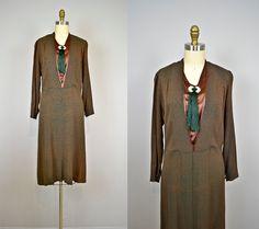 1920s dress / 20s Gold Embossed Geometric Art Deco Crepe & Copper Silk Flapper Dress. $225.00, via Etsy.