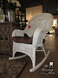 "White wicker rocking chair with tie on brown cushion. Great buy for a lanai or sunroom. Measures 30""wide x 38""deep x 39""high. At posting, we have a matching stationary chair."