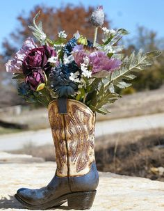 cowgirl boots with flowers as a vase | Wedding Ideas / Western Boot flower vase. Cute!
