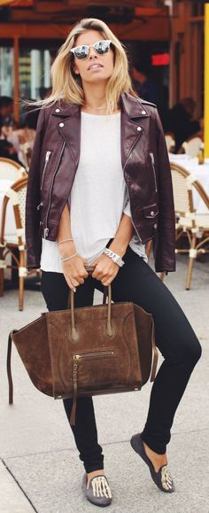 Tasha Oakley looked so chic in a white tee, maroon moto jacket, black jeans, and loafers paired with a Céline tote and sunglasses.