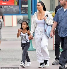 Kim Kardashian puts on busty display in a braless tank top while visiting Disneyland with North West Kim Kardashian And North, Kardashian Jenner, Kourtney Kardashian, Kanye West Kids, Celebrity Style Inspiration, Celebrity Kids, Crop Top And Shorts, Girl Outfits, School Outfits