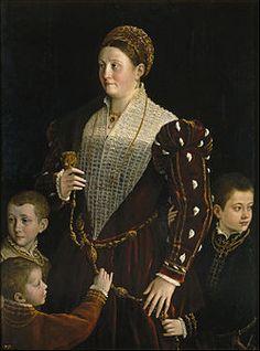 Ritratto di Camilla Gonzaga e i tre figli. 1539-1540. Olio su tavola. 128x97. El Prado. Fa da pendant al ritratto di Pier Maria de' Rossi.  Sempre al Prado.