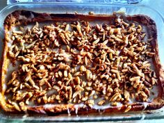 Pumpkin gooey butter cake with brown butter glaze and spiced nuts