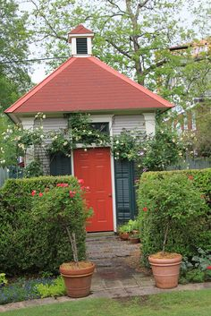 Potting Shed... Love the red door.