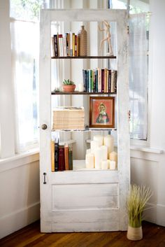 Vintage door repurposed into a bookshelf.