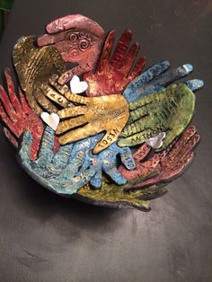 """""""Handmade"""" bowl of hands of classmates as a gift for teacher. Made with sculpy clay, stamps, acrylic paint, and glass bowl as a mold."""