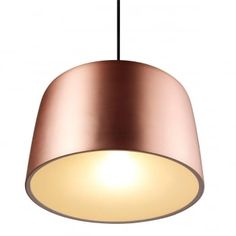 A modern ceiling pendant in a brushed copper finish with an oiled walnut shade top. Features a soft cream finish to the inside of the shade for a softly diffused illumination.