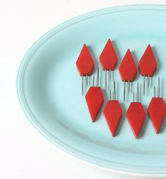 Vintage Red Bakelite Corn Holders. I have these in green found at a tag sale - they're so awesome!