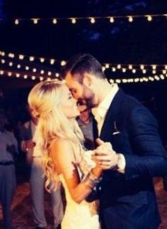 bride and groom dancing under bistro lighting http://www.itgirlweddings.com/blog/9-wedding-lighting-trends