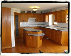 Kitchen With Oak Cabinets And New Wood Floors Savannah