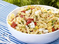 Pasta Caprese from FoodNetwork.com  Looking for a yummy pasta salad for your BBQ today? This is my favorite. I follow the instructions, but use grape tomatoes cut in half, extra basil, campanelli pasta (because it is gorgeous) and 16 oz mozzarella. Delicious and pretty!  ~Jo
