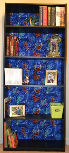 Easy way to dress up a bookcase with fabric!