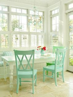 Love the white table and colored chairs. Mint or Tiffany blue two big colours for spring in home decor and fashion. 2013.