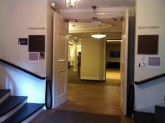Foyer of Park Street Church in Boston. Two circular staircases lead to the sanctuary upstairs. The doorway leads to meeting rooms and classrooms. (Photo: Sarah Sundin, July 2014)