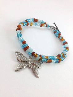 Blue and Brown Beaded Butterfly charm bracelet by OpenHeartOneLove