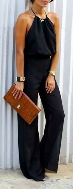 Street style, black jumpsuit + black and gold accessories.