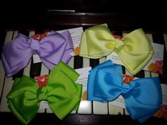 Hair Bow Clip. One Hair Bloom hair accessory by BySunshineDesign, $5.95