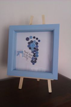 """Baby Footprint Button Box Frame Picture. Title it """"Cute as a button"""" Stamp the babies foot print first then glue the buttons on after. Great gift for Grandparents day!"""