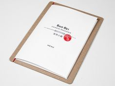 Have never seen a menu solution quite like this. A clipboard and bi-fold menu…