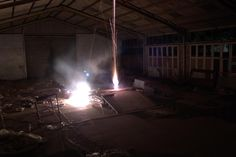 Firework in an abandoned bus depot  - http://earth66.com/exposure/firework-abandoned-bus-depot/