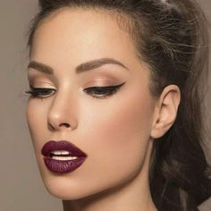 Beautiful make up.brown color with cat eye...dark lip stick
