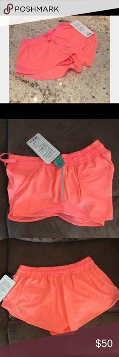 """Lululemon """"Hotty Hot"""" Shorts Bright Orange. Reflective strip on the side. Size 10 lululemon athletica Shorts"""