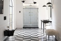 black and white bathroom chevron tile http://freshome.com/2014/12/08/10-things-interior-decorators-dont-want-you-to-know/