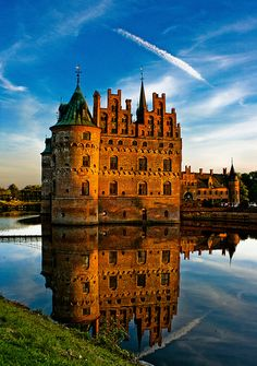 Danish Egeskov Castle is located in the south of the island of Funen, Denmark. The castle is Europe's best preserved Renaissance water castle. Egeskov's history dates to the 14th century. The castle structure was erected by Frands Brockenhuus in 1554.