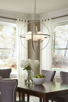 The silhouette of the modern Alturas lighting collection by Sea Gull Lighting features an interlocking, spherical steel frame, which harkens back to the Unisphere constructed for the 1964 New York World's Fair.