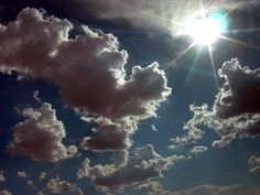 sun seeps in through the puffiness of the clouds.