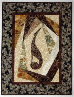 """This wall hanging quilt is called """"Elegant Dreams,"""" by Gryffinn Designs. So many beautiful pieces; I'd gladly own any one of them. I've seen her work up close, and the piecing and quilting is beautiful."""