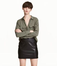 Khaki green. Long-sleeved shirt in woven viscose fabric with a collar, chest pockets with flap, and slits at sides. Slightly longer at back.