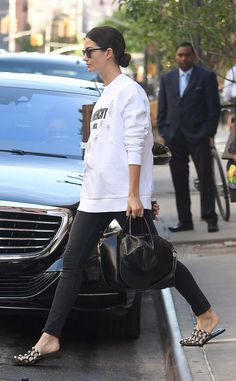 Lily Aldridge in Givenchy top and bag, Saint Laurent sunglasses, Paige jeans, and Alexander Wang shoes.