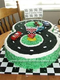 Homemade Cars Racetrack Birthday Cake: I made two 14 inch round cakes for this Cars Racetrack Birthday Cake using Wilton's Perfection pans. I cut a portion of the middle of each cake so that