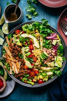 This vegan taco salad is loaded up with all the good stuff: spicy lentil walnut taco meat, tortilla strips, all sorts of veggies, pinto beans and avocado. Ready in less than 30 minutes, it's easy to customize and perfect for a nutritious, gluten free weeknight dinner! #vegantacosalad #tacosalad #veganmeat #vegantacomeat #vegetarian #glutenfree #tacos #vegandinner #vegansalad #mealprep #foodphotography | crowdedkitchen.com Taco Bake, Taco Casserole, Tacos Vegan, Healthy Tacos, Healthy Recipes, Clean Recipes, Avocado Dressing, Spicy Walnuts, Taco Salad Ingredients
