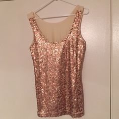 Banana Republic sequin tank Super cute on layered under a jacket or sweater or alone with cute pants or skirt. Worn handful of times. Great condition. Banana Republic Tops Tank Tops