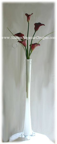 Google Image Result for http://sharonnagassardesigns.com/WeddingCenterpieces/EiffelTowerCenterpieceTALL.jpg