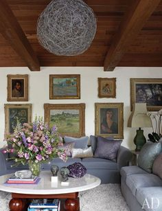 Elizabeth Taylor's home in Bel Air. Paintings in the room include a large landscape by Camille Pissarro and, above it, a smaller one by Vincent van Gogh. A mohair velvet from Thomas Lavin covers the sofas; the flowers are by David Jones.